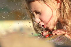 Girl drinks water. Quenching his thirst Stock Photos