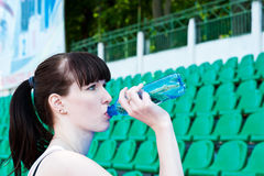 Girl drinks water. From a bottle Stock Images