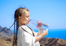 Girl drinks water Royalty Free Stock Photography