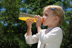 The girl drinks water from a bottle Stock Photos