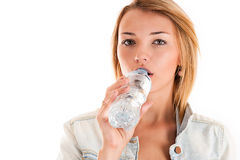 Girl drinks water from a bottle Royalty Free Stock Photo