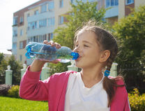 Girl Drinks Water From A Bottle Stock Images