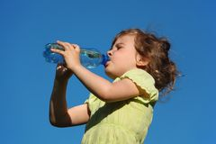 Girl Drinks Water From Plastic Bottle Stock Images