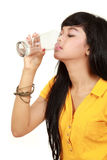 Girl drinks water from glass Royalty Free Stock Photography