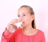 Girl drinks water from a glass Stock Photography
