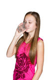 Girl drinks water from a glass Royalty Free Stock Photos