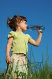 Girl drinks water from  plastic bottle Royalty Free Stock Image