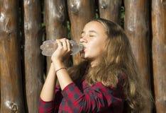 Girl drinks water Stock Image