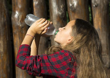 Girl drinks water Stock Photos
