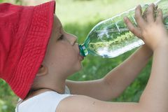 The girl drinks water stock photography