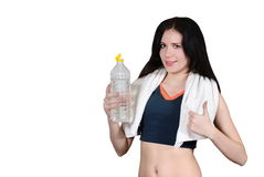 The girl drinks water with a towel on a white background Royalty Free Stock Image