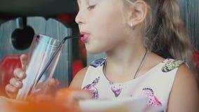 Girl drinks yellow juice. Closeup stock video