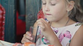 Girl drinks yellow juice. Closeup stock video footage