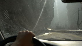 Girl drive along the road in a deep ravine in foggy weather, examining the rocks. We drive along the road in a deep ravine in foggy weather, examining the epics stock video footage