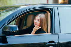 Girl drive car and look from window Royalty Free Stock Photography