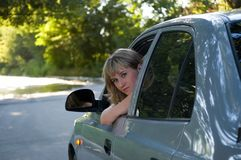 Girl driver. Malicious girl-driver looks in the chamber Stock Image
