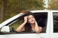 Girl driver inside car portrait, eyes closed and dreaming , summer season Royalty Free Stock Photography
