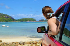 Girl driver at the ocean shore Stock Photography