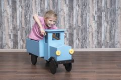 Girl drives a toy truck stock image