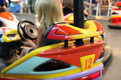 Girl driving. Girl having a ride in the scooter at the fun fair royalty free stock photos