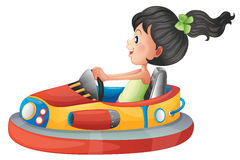 A girl driving the bumpercar Royalty Free Stock Photo