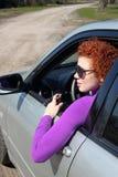 Girl driving car Stock Photos