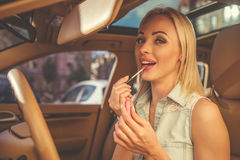 Girl driving the car stock images