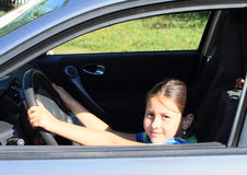 Girl driving a car Stock Images