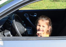 Girl driving a car Royalty Free Stock Photos
