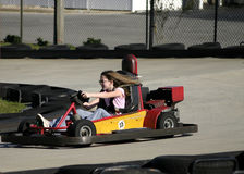 Girl driving go cart Stock Photo