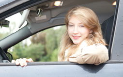 Girl driving her new car Stock Images