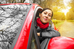 Girl driving a red car. Autumn stock photography