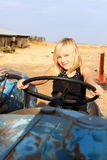 Girl Driving Tractor Stock Photo