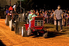 Girl Driving Tractor at Pulling Competition Stock Photography