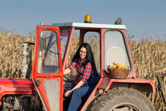 Girl driving tractor Royalty Free Stock Image