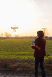 Girl with drone flying at sunset Royalty Free Stock Photography