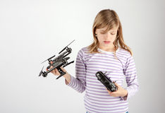 Girl with drone and remote control Royalty Free Stock Photos