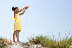 Girl dropping sand Royalty Free Stock Photography