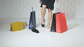 Girl drops shopping bags stock footage