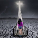 Girl on drought land walk to the heaven Stock Image