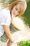 Girl with drum Stock Image