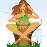 Girl with a drum. A girl in green clothes plays on a drum Royalty Free Stock Images