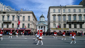 Girl drummers marching down Nevsky Prospekt in St. Petersburg during the festive demonstration Royalty Free Stock Photo