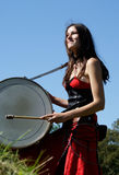 Girl drumming Royalty Free Stock Photos