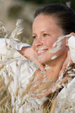 Girl in dry grass Royalty Free Stock Image