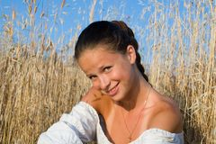 Girl in dry grass Stock Photography