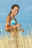 Girl in dry grass Stock Image