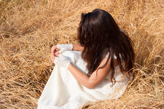 Girl on dry grass Royalty Free Stock Photos