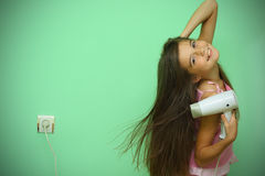 Girl dry his hear Royalty Free Stock Image