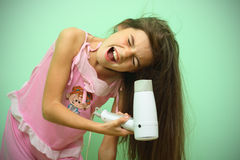 Girl dry his hear Stock Image
